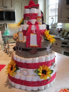 Cowgirl/Western theme diaper cake with sunflowers and hints of red bandanna and brown fabrics!